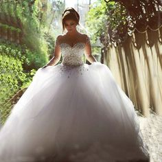 I found some amazing stuff, open it to learn more! Don't wait:https://m.dhgate.com/product/2015-wedding-dresses-real-image-luxury-crystal/249588738.html
