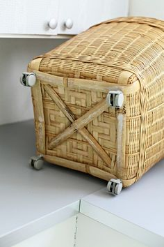 "I would fasten 1/4"" plywood to basket bottom, maybe inside and outside, then attach wheels to that, to make it more sturdy."