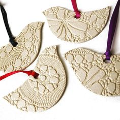Porcelain clay ornaments, cut out in bird, heart, and angel shapes, textured with heavy lace