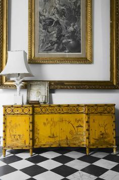 The yellow chinoiserie chest - for entry on black floor? Not this formal of artwork...  Love the double gold frames (frame around a frame)