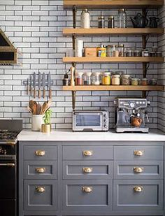 Gray & gold, subway tile with dark grout, open shelves, brass hardware