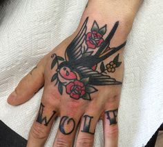 Traditional sparrow and rose tattoo on Palm. Script on knuckles.