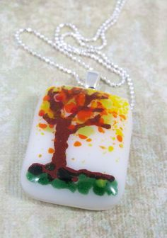 Wear your fall colors.  Hand painted fall tree.  Fused glass necklace made by Little Pine Jewelry.