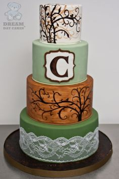 Hand Painted wedding cake by Dream Day Cakes. Hand painted branches, monogram, and lace complete this fall themed wedding cake.