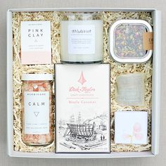 Contents - The English Garden candle by Teak & Twine with pink & silver foil label - Dick Taylor chocolate bar - Infused honey by Cloister Honey wrapped in a linen pouch - Sugarfina artisan gummi swee