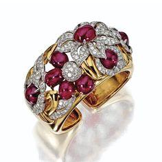 Gold, cabochon ruby and diamond bangle-bracelet, circa 1940