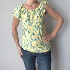 SALE Lilly Pulitzer floral ruffle collar tank Lilly Pulitzer ruffle collar tank    Pre-owned, great condition, no holes or stains. This is a size small. Made of 100 % cotton.  Measurements: underarm to underarm flat across is approximately 16 inches. Top of shoulder to bottom of hem is approximately 15 inches. Lilly Pulitzer Tops Tank Tops