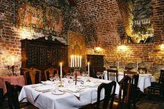 """Cyrano de Bergerac Restaurant in Krakow. """"Its location, in the cellars of a medieval building from the end of the 15th century, is one of the factors that put the venue on Krakow's map of the best cultural restaurants. Just a short walk from the Main Square, Cyrano de Bergerac is a great place to sample expertly prepared French dishes in this unique ambience, and has also been visited by the likes of Roman Polanski and Prince Charles."""""""