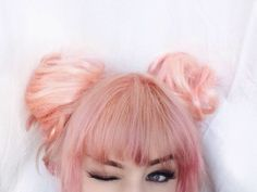 Pastel Pink hair with straight bangs and double buns