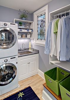 crisp and clean laundry room with a stained glass window as the focal point - love the fresh colors!