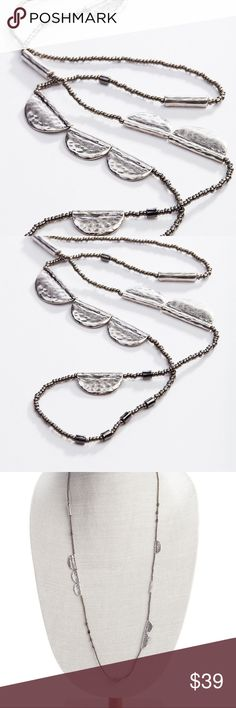 Beautiful and Stylish Beaded Layering Necklace single-strand necklace has a mix of hammered-metal half-circle disks interspersed with metal, acrylic and glass beads.   Grey silk cord. 36. J. Jill Jewelry Necklaces