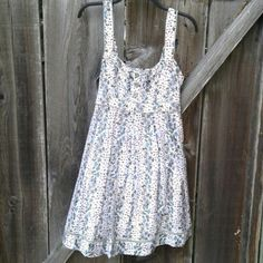Floral fit and flare dress Sz 8, EUC, lined floral dress with button and rufgle detail at neckline and a sash to tie at waist. Ivory with floral pattern, piped in green. There's an open crochet detail near the hemline. So feminine and sweet :) Jessica Simpson Dresses