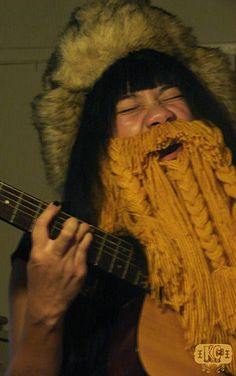 sometimes you just wish you had a beard to rock out in. this lady found a solution.