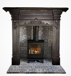 Buy online - See our Circa 1895 Victorian cast iron surround - Price: - Part of our Range Wood Burner Stove, Wood Burner Fireplace, Cast Iron Fireplace, Black Fireplace Surround, Wood Fireplace Surrounds, Fire Surround, Log Burner Living Room, Living Room With Fireplace, Fireplace Remodel