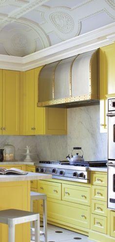 Bold detailing mix + Classic architecture yellow kitchen  range hood
