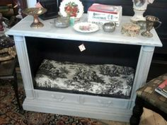 Old tv console into table and pet bed. Love this!