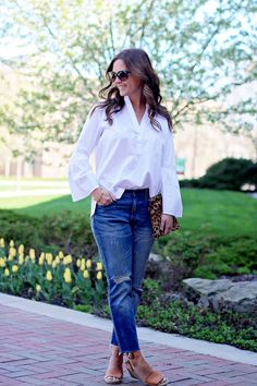 jillgg's good life: tiptoeing in the tulips! White bell sleeves blouse+distressed jeans+camel wedges+leopard print clutch+sunglasses. Spring Casual Outfit 2017