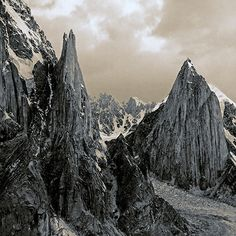 What are five all-time favorite shots of TNF veteran photographer/filmmaker @timkemple? Go behind the lens with Tim as he shares the adventures behind his most spectacular photographs. Read his blog @ neverstopexploring.com Photo: Sept 20, 2007- Cat's Ears Spire, Shipton Spire, and The Flame - Trango Towers, Pakistan #Padgram