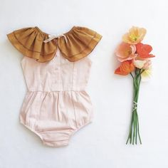 Blush pink and mustard for the win. Cute summer outfit for little girls.