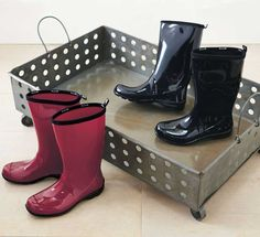 """This roomy boot tray made from punched metal stands up to all the elements. Station it in your mudroom or at your back door and slip out of your soiled hiking shoes or boots, then hose them down and walk away. 31""""L x 19""""W x 8.5""""H"""