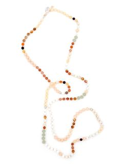 "Desert Moon Necklace, $75 - Luminescent gemstone beads mix with earthy hues on this long, beaded necklace — wear it long, or wrap it around twice for a shorter and/or asymmetrical length.    -  Gemstone / glass / metal beads   -  Strung on waxed cotton cord   -  Adjustable 46"" — 50"" length"