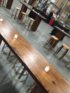 Rustic stools paired with long bistro tables transform this event taking place in a warehouse. Bistro Tables, Rustic Stools, Corporate Events, Warehouse, Celebration, Dining Table, Places, Furniture, Home Decor