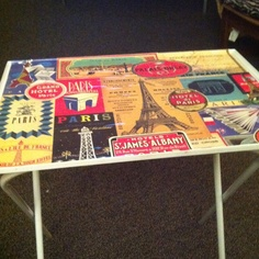 Tv tray table at a yard sale, fresh coat of spray paint- picked up some vintage paper and voila! New cute tv tray!
