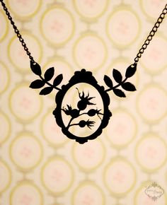 Victorian Framed Rose Hips and Leaves necklace in black stainless steel - silhouette statement flower jewelry