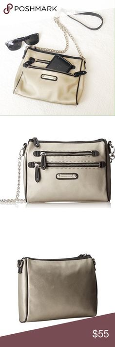"Franco Sarto | Class Act Shoulder Bag Beautiful Metallic Silver chain shoulder bag in perfect condition! Only used once! Has two pockets in the front and 3 inside and a removable chain! OFFERS ARE WELCOME!  Bag size: 7 "" X 9.5"" Chain size: 24"" Franco Sarto Bags Shoulder Bags"