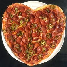 For Valentine's Day, @MargotsPizza likes to make a special heart-shaped pizza. This one is HOT—spicy pepperoni, pickled jalapeños, and a drizzle of Mike's Hot Honey.