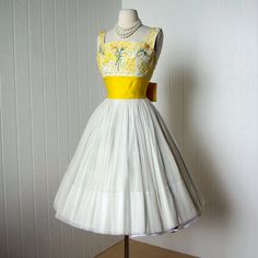 Betty's new lemon fresh dress w/pearls for Sunday Brunch with the Pattersons!!    ephemeralness:  Picture from:Vintage Rose Garden by taven7-  (via vintage 1950's dress beautiful creamy chiffon and by traven7)