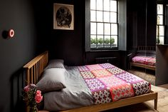 Black bedroom with lots of natural light
