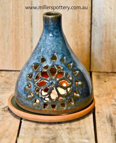 Australian handmade ceramic candle holder by www.millerspottery.com