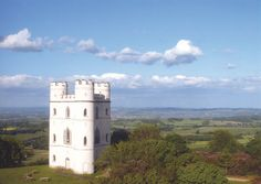 Haldon Belvedere, also known as Lawrence Castle, is a Grade II* listed triangular tower perched high on Haldon hill and standing in 5 acres of woodland, it has panoramic views extending to Dartmoor, Exmoor and the River Exe valley. Devon England, Devon Uk, Exeter City, Stay In A Castle, Castles In England, Devon And Cornwall, Dartmoor, Stunning View, Great Britain