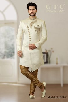Charm your way through everyone's hearts at any special occasion by donning this modish GTC- Classic Sherwani handicrafted on Silky Jacquard fabric. It has a stylish asymmetrical cut and is embellished with meticulously detailed regal hand-beaded work on the collar and front-panel. It has an unique desing never seen before and a delight for a modern-day fashionista to don. It is paired with a gold brijis. Design-style & Color-scheme customizations available.   Wedding Kurta For Men, Wedding Sherwani, Suit Fashion, Fashion Show, Fashion Design, Mens Sherwani, Indian Groom Wear, Mehndi Ceremony, Western Suits