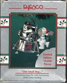 Enesco One Small Step Ornament 25th Anniversary of the Lunar Landing  This ornament is beautifully crafted to show every detail of the Space Module, which is decorated with stars, the sun, and the moon, and a plaque that reads 1969 - 1994 with the American Flag in the center. Climbing up the side is an astronaut Bunny carrying a green bag on his back and wearing a Santa Hat over his head gear. The piece is marked on the bottom 1994 Enesco Corporation. Designed by K. Hann. Made in China.