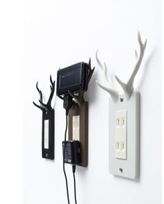 Antler Phone holder in black or white... awesome! Will look cool in the computer station area...