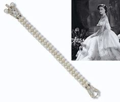 JEWELLERY AND FABERGE, FROM THE COLLECTION OF H.R.H THE PRINCESS MARGARET, COUNTESS OF SNOWDON: AN ART DECO CULTURED PEARL AND DIAMOND BRACELET. The double row of cultured pearls bordering a millegrain-set line of circular-cut diamonds to the cultured pearl and diamond openwork geometric shield-shaped clasp, circa 1925.