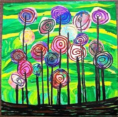 rough draw circles on paper and have students cut them out. Draw concentric circles with oil pastel, then water colored over top. Draw green line for the background. When dry glue circles down and add black lines.