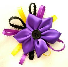 Check out this item in my Etsy shop https://www.etsy.com/listing/471380572/purple-flower-bow-halloween-bow-handmade
