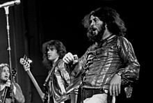 Gentle Giant were a British progressive rock band active between 1970 and 1980. The band was known for the complexity and sophistication of its music and for the varied musical skills of its members. All of the band members, except the first two drummers, were multi-instrumentalists. Although not commercially successful, they did achieve a large cult following.