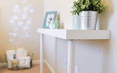 When we weremaking over Amy's guest bedroom a while back, we weren't working with a ton of space -- or a ton of money! We needed a little table where her guests could set their keys or toilet...