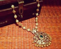 Jewellery Designs: Polki Pendant by Sakhi Fashions