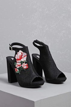 A pair of denim sandals featuring a floral embroidery along the vamp, a platform sole with a chunky heel, peep toe, heel cutout, and a buckled ankle strap closure.<p>- This is an independent brand and not a Forever 21 branded item.</p>