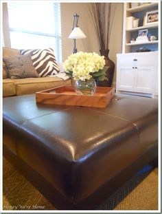 Decorating ideas~ I would love one of these ottomans/coffee tables