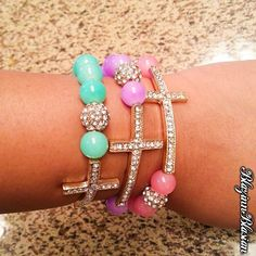 normally not a cross person but i love the colors and sparkles of these bracelets. Studs And Spikes, Jewelry Accessories, Fashion Accessories, Catholic Jewelry, Bangles, Beaded Bracelets, Scarf Jewelry, Jewelery, Bling