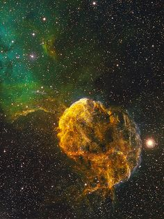 """IC 443 - The Jellyfish Nebula by Bob Franke, who says: """"The image uses the Hubble Palette. The SII data (sulfur) are mapped to the red channel, the Ha (hydrogen) to the green and the 0III (oxygen) data are mapped to the blue channel. IC 443, the Jellyfish Nebula, is a Galactic supernova remnant, in the constellation Gemini that occurred 8,000 years ago. IC 443 spans about 65 light-years at an estimated distance of 5,000 light-years by Bob Franke"""