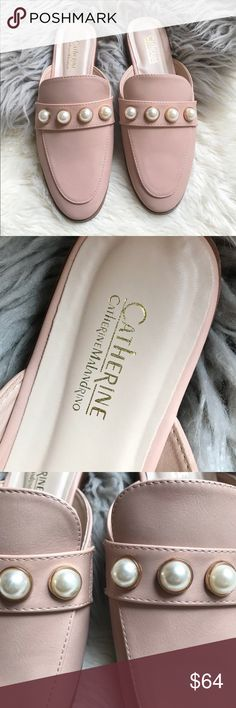 "Catherine Malandrino Quentin Mule Pink Faux Pearl Catherine Malandrino Women's Quentin Size 6.5 Slip On Mule Pink Faux Pearl  A row of imitation mabe pearls adds luxe style to a pair of faux leather mules comfortable enough for all-day wear.  - Moc toe - Banded vamp with imitation mabe pearls - faux Leather construction - Slip-on style - Lightly cushioned footbed - Low heel - Approx. 7/8"" heel - Imported - All Materials manmade   Pearls have a few light scratches as shown Catherine…"