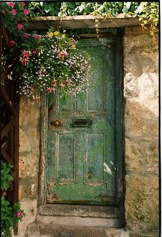 stone walls and a green door. nice combo.