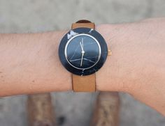 Flaunt a minimal design from your wrists in the form of this Black Marble Round Mason Watch by Gessato.